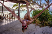 Woman posing at romantic hammock in private house near tropical beach — Stock Photo