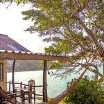 Romantic hammock in private house near tropical beach — Stock Photo #57096405