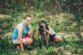 Nature photographers. Man and woman in jungle — Stock Photo