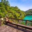 View wooden platform near the blue lagoon in marine national park and girl looking on lake — Stock Photo #60653809