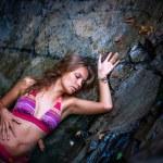 Beautiful sexy model posing in water of waterfalls wearing bikini swimwear at summer time — Stock Photo #60736715