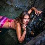 Beautiful sexy model posing in water of waterfalls wearing bikini swimwear at summer time — Stock Photo #60736859