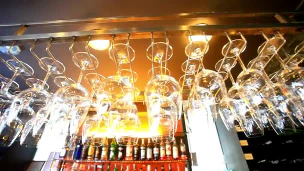 Empty glasses hanging at the bar and Bar with bottles Blurred Background. HD. 1920x1080 — Vidéo