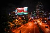 BANGKOK, THAILAND, 4 AUGUST 2014, Traffic on a road in the city centre. Night time — Stock Photo