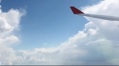 View on sky and clouds. Wing of airplane from window. HD. 1920x1080 — Stock Video