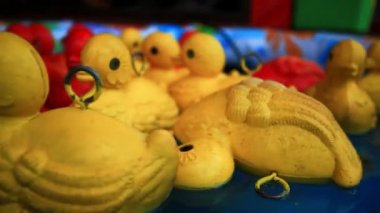 Close  up of floating yellow rubber duckies. HD. 1920x1080 — Stock Video