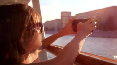 Young beautiful woman with sunglasses taking picture With smartphone in sea voyage on cruise ship. HD. 1920x1080 — Stock Video