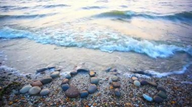 Christmas 2015 made of small stones on the sandy beach. HD. 1920x1080 — Stock Video