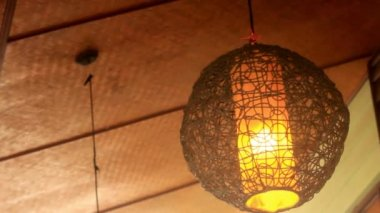 Wicker round lantern hanging and swaying in wind at cafe — Stock Video