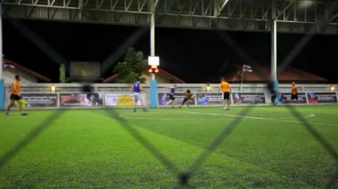 THAILAND, KOH SAMUI, 16 july 2014 Soccer players on the field at night with lighting — Stock Video