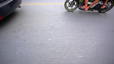 Part of a motorcycle with blurred road and wheels. HD. 1920x1080 — Stock Video