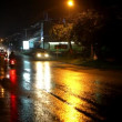 Cars and motorbikes driving on a wet road at night after rain. Video — Stock Video #65848951
