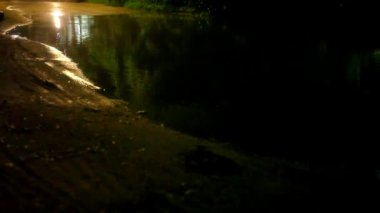 Motorbike  drives through a puddle on the road at night after rain. Video — 图库视频影像