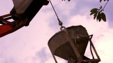 Industrial Crane operating and lifting cement tank against sky. Video — Stock Video