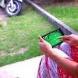 Woman using mobile phone touch screen. Paying a game on her phone. Video — Stock Video #66075067