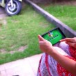 Woman using mobile phone touch screen. Paying a game on her phone. Video — Stock Video #66075075