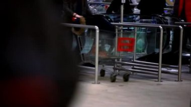 Russia, moscow, 12 february, 2015. People with Shopping cart go shopping on escalator. HD. 1920x1080 — Stock Video