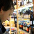 Man choosing products in alcoholic during weekly shopping at supermarket store. HD. 1920x1080 — Stock Video #66215839