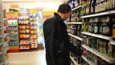 RUSSIA, 14 FEBRUARY 2015, man choosing products in alcoholic during weekly shopping at supermarket store. HD. 1920x1080 — Stock Video