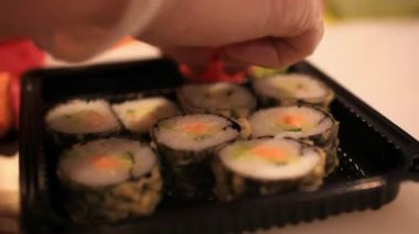 Close up of sushi chef puts in a container for sale In Japanese store. HD. 1920x1080 — Stockvideo
