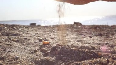Womans hand touch and pour sand in the beach at sunlight — Stock Video