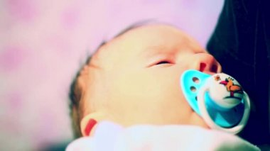 Beautiful little baby slumber sleep  with a pacifier in his mouth — Stock Video