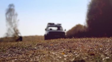 Off road SUV vehicle running in autumn forest on road — Stock Video