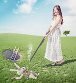 Alice kills white rabbit — Stock Photo