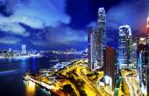 Hong Kong highrise buildings at night — Stock Photo