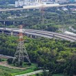 Highway Traffic and transmission tower  — Stock Photo #61280905