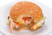 Bitten sandwich on white plate — Stock fotografie