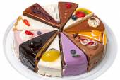 Twelve different pieces of cake on a plate — 图库照片