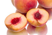 Two peach halves — Stock Photo