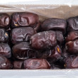 Dried dates (tropical fruit) in the box — Stock Photo #60826555