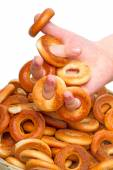 Child hand with small bagels  — Stock Photo