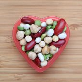 Mixed legume beans in a heart bowl — Stock Photo