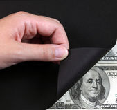 Turn black page and money — Stock Photo
