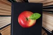 Old books and apple — Stock Photo