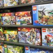 Постер, плакат: Lego boxes on shelves