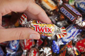 Twix candy in woman's hand — Stock Photo
