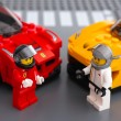 Lego drivers minifigures by LEGO Speed Champions with car — Stock Photo #77292622