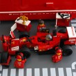 Постер, плакат: Pit stop of Ferrari F14 T race car by Lego Speed Champions