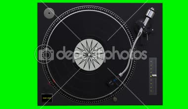 Turntable spinning vinyl records on green chroma key background — Stock Video