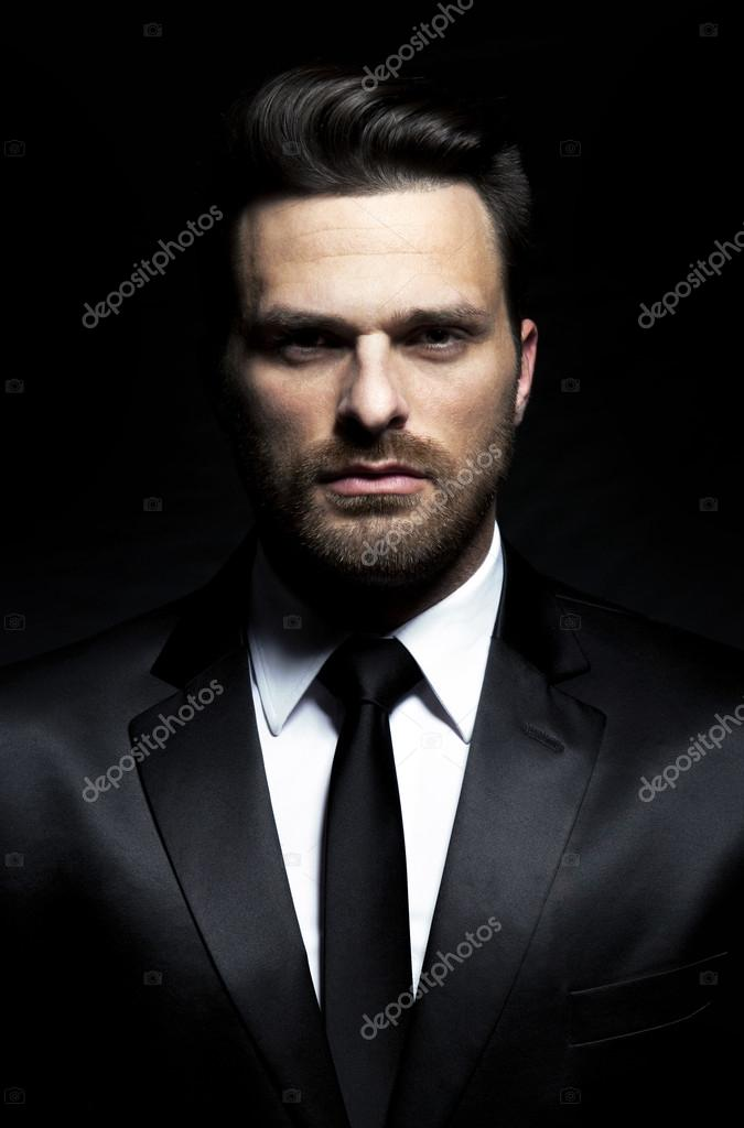 depositphotos_56652509-stock-photo-handsome-man-in-suit.jpg