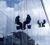 High altitude window washers — Stock Photo