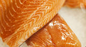 Salmon steaks on ice, on display in fish store — Stock Photo