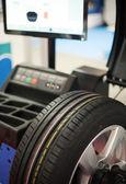 Computerized tire balancing machine — Stock Photo