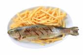 Grilled trout with French fries — Stock Photo