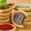 Jam and chocolate filled tartlets — Stock Photo #58707895