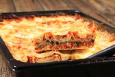 Lasagne in a baking pan — Stock Photo